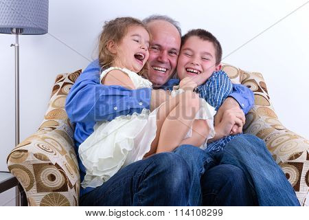 Middle-aged Father With Two Laughing Kids