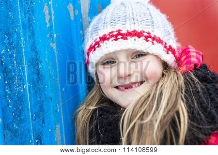 Close portrait of happy 8 years old Caucasian girl outside in winter