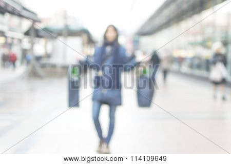 Sale. Happy Young Woman With Shoping Bags On Blurred City Street Background