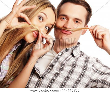 young couple making fake moustache from hair