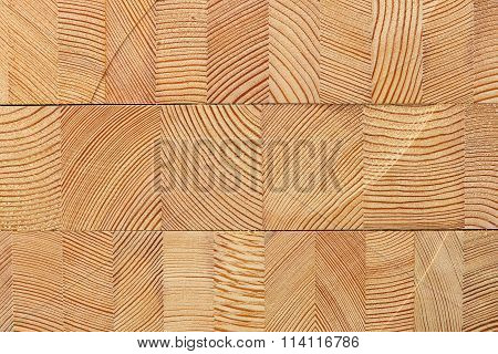 Wooden background with glued larch wooden blocks.