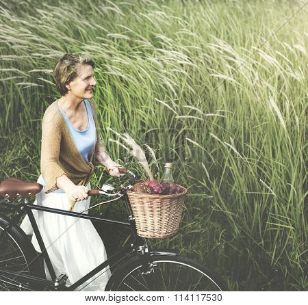 Senior Woman Bicycling Windy Park Concept