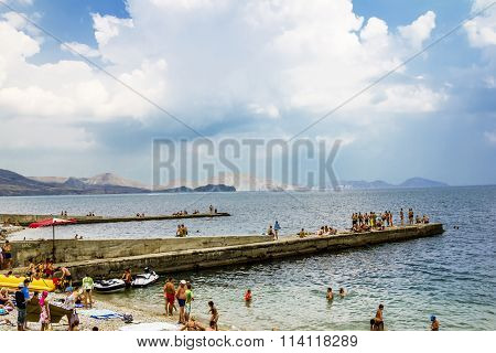 Vacationers On A City Beach In The Settlement Koktebel In Crimea