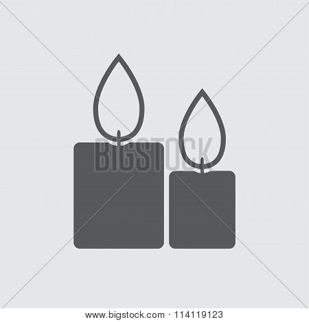 Candle icon with flame. Vector Illustration of two burning candles.