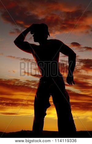 Silhouette Cowboy No Shirt Hand On Hat Look To Side