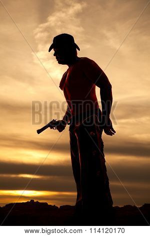 Silhouette Cowboy No Shirt Hold Pistol At Waist