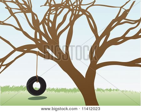 Tire Swings Hangs From Leafless Tree In Grass Field Daytime