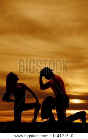 Silhouette Of A Cowboy On His Knee Looking Down By Woman Looking Up