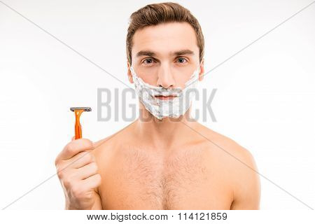 Pretty Young Man With Shaving Foam On His Cheeks Holding A Razor