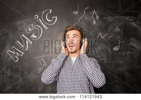A Young Musician With Head-phones Looks Up