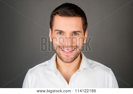 A Cheerfull Young Man In White Shirt