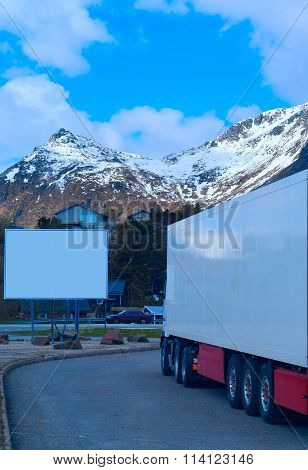 White Refrigerated Truck And Big Empty Billboard