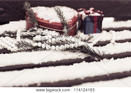 White Pearl Necklace, Red Heart Shaped Tin Box With A Gift Box And A Fragment Of A Pine-tree Branch