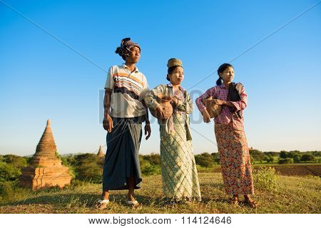 Group of Asian Burmese traditional farmers carrying clay pots going back home, Bagan, Myanmar