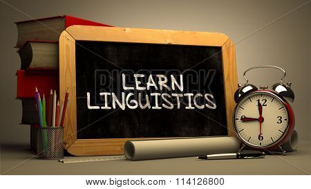 Hand Drawn Learn Linguistics Concept on Chalkboard.