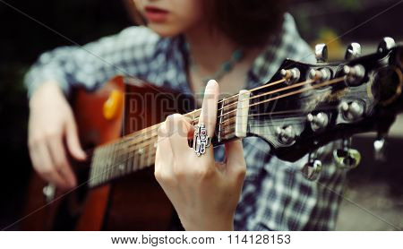 Girl Guitarist Plays