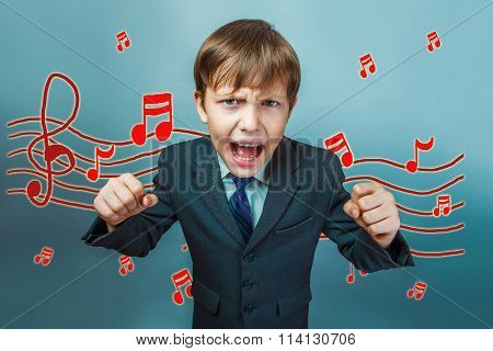 business style of teen boy clenched his fists and screaming musi