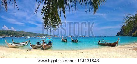 Thailand, Koh Lanta-May 2014: Tropical beautiful beach with crystal clear water and boats