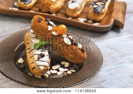 Cakes Eclairs, Mint, Berries Physalis