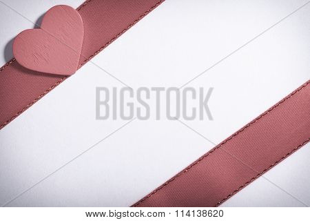 Red Ribbon And Heart Love Symbol On White