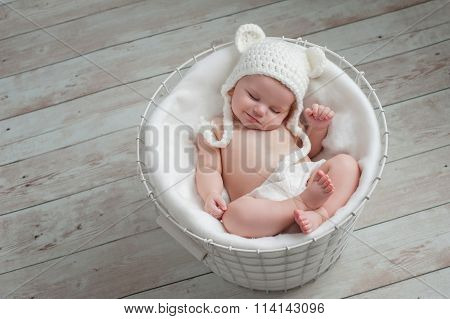 Smiling Baby Wearing A White Bear Hat