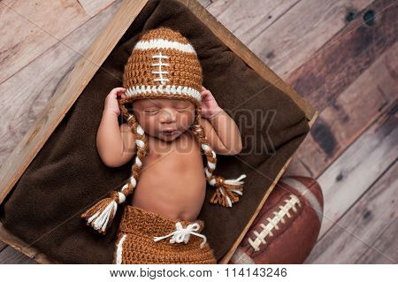 Newborn Baby Boy In Football Costume
