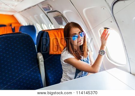 Woman looking at window of airplane