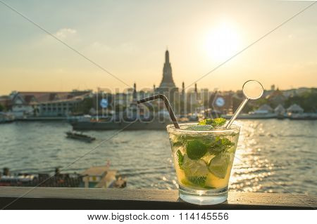 Mojito Cocktail On Table In Rooftop Bar With Famous Place Background. Wat Arun ,bangkok ,thailand