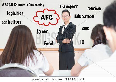Asain Students Listening Teacher About Asean Economics Community (aec) In Classroom