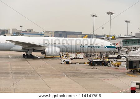 SINGAPORE - NOVEMBER 07, 2015: Cathay Pacific Boeing 777 in Changi Airport. Singapore Changi Airport is the primary civilian airport for Singapore