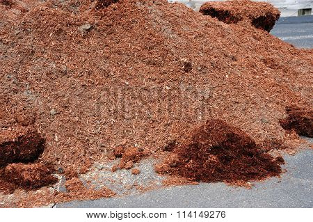 mulch in pile for gardening