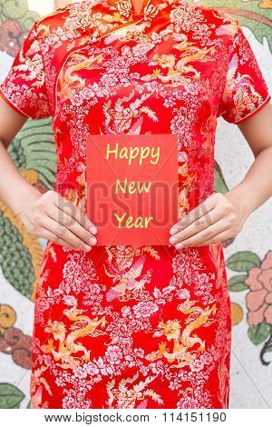 Happy Chinese New Year Asian Woman With Red Cheongsam Holding A Red Packet Wishing You