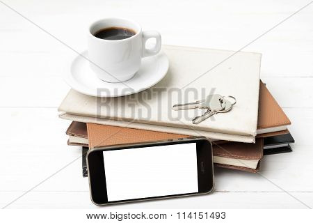 Coffee Cup With Phone,key And Stack Of Book