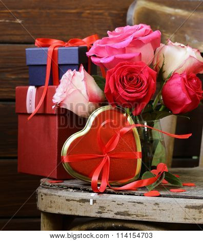 Rose flowers, hearts and holiday gifts for St. Valentine Day