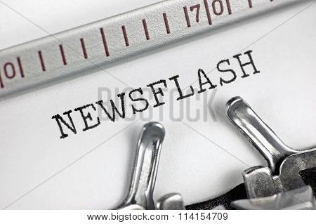 Typewriter detailed macro closeup typing text Newsflash, large detail vintage press, TV, radio, internet mass media journalism metaphor, newspapers, magazines, broadcasting television journalist latest news flash concept studio shot, horizontal