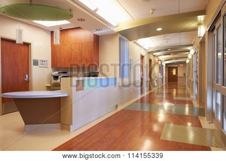 Empty Nurses Station And Corridor In Modern Hospital
