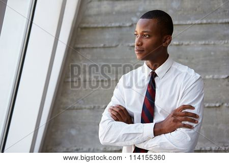 African American Businessman Standing Against Wall