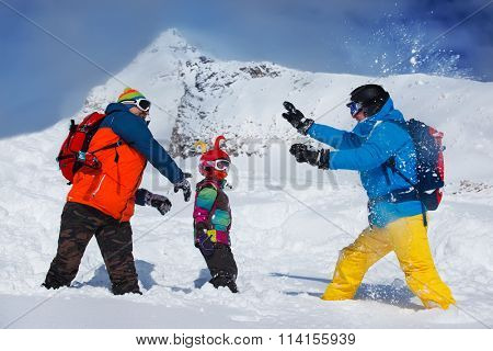 Friends playing snowballs at the ski resort