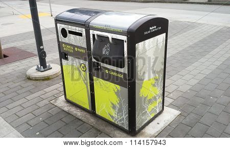 SURREY, BC, CANADA, MARCH 2015.  The city of Surrey installs solar powered trash cans and recycling bins.