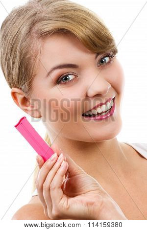 Happy Woman Looking At Pregnancy Test With Positive Result