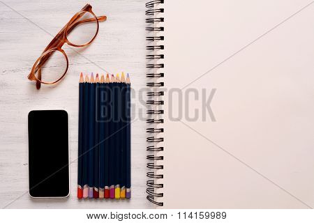 Blank Sketchbook With Color Pencils And Other Items