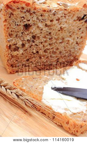 Slice Of Bread With Butter And Ears Of Wheat