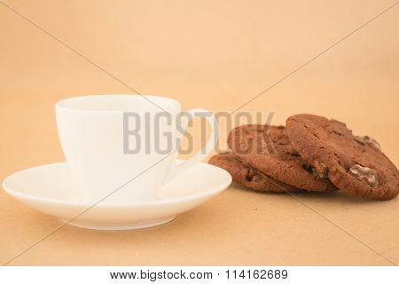 White Mug Of Hot Coffee And Chocolate Cookies