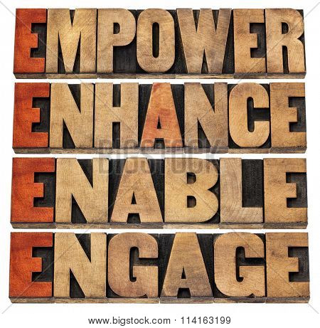 empower, enhance, enable and engage - motivational leadership and business concept - a collage of isolated words in letterpress wood type stained by red ink