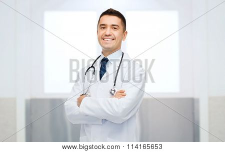smiling male doctor in white coat