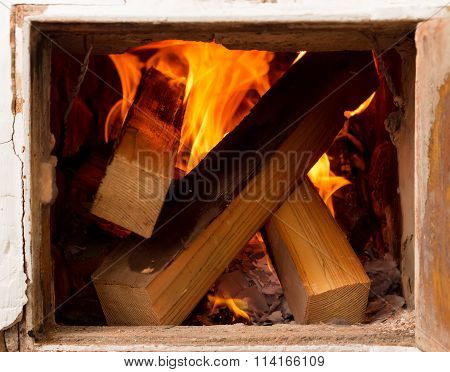 Open Door, Rustic Stoves, Burning Wood And Fire. Heating Homes An Alternative Method