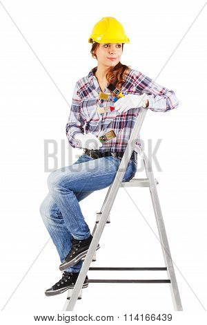 Young Smiling Worker Sits On The Building Stairs