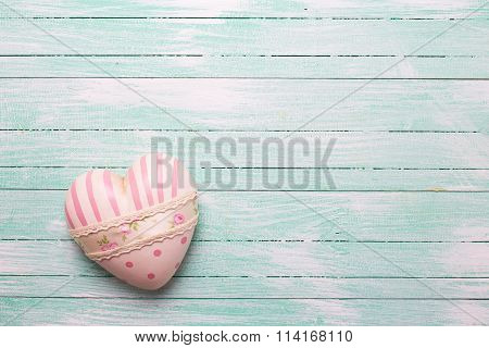 Decorative White And Pink  Heart On Turquoise  Wooden Background.