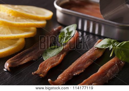 Anchovy Fillets And Lemon Macro On A Slate Board. Horizontal