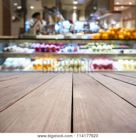 Table Top With Blurred supermarket  With Fruit Display On Backround